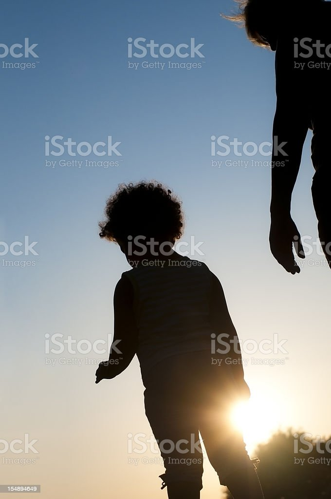 Silhouette of Child with Her Grandmother stock photo