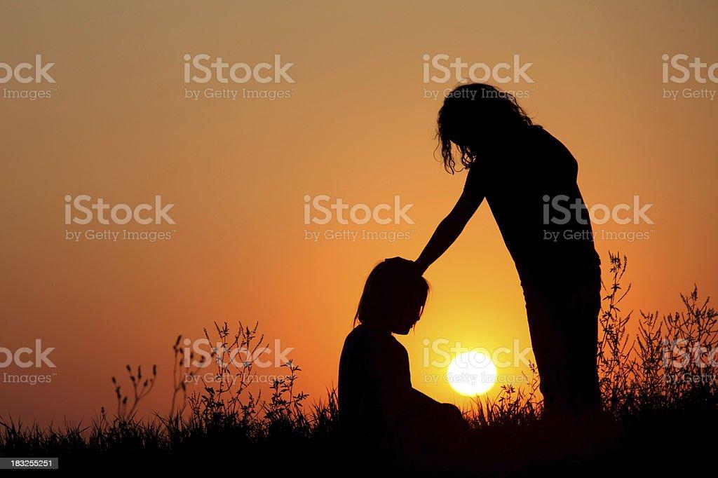 Silhouette of Children Praying royalty-free stock photo
