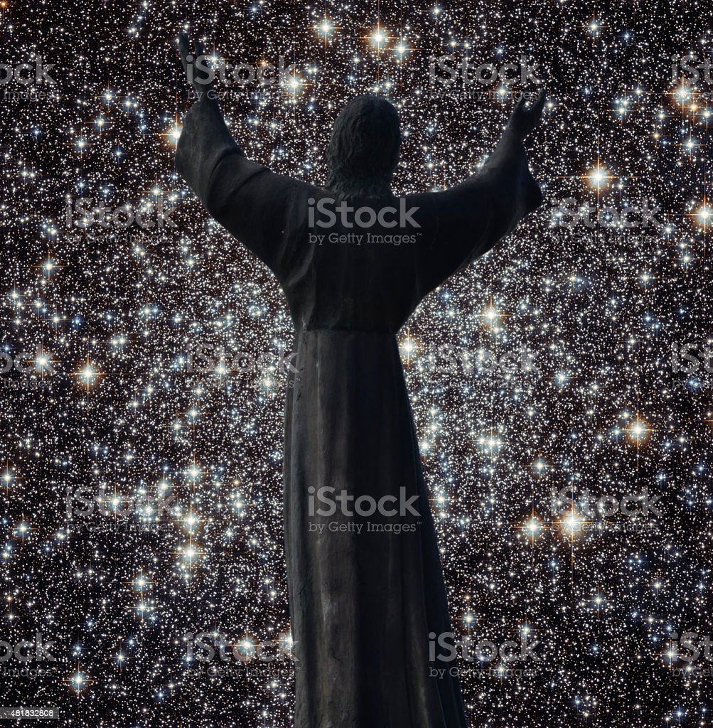 Silhouette Of Christ Statue and Hubble space photo background stock photo