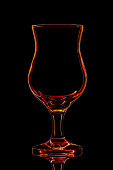 Silhouette of cocktail glass on black background