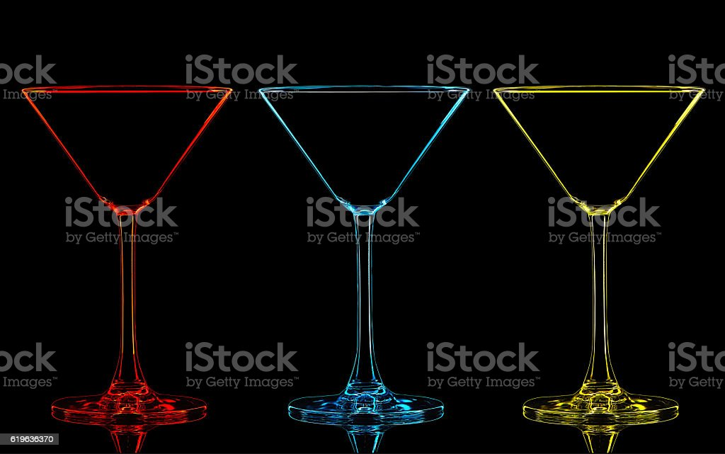Silhouette of color martini glass on black stock photo