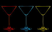 Silhouette of color martini glass on black