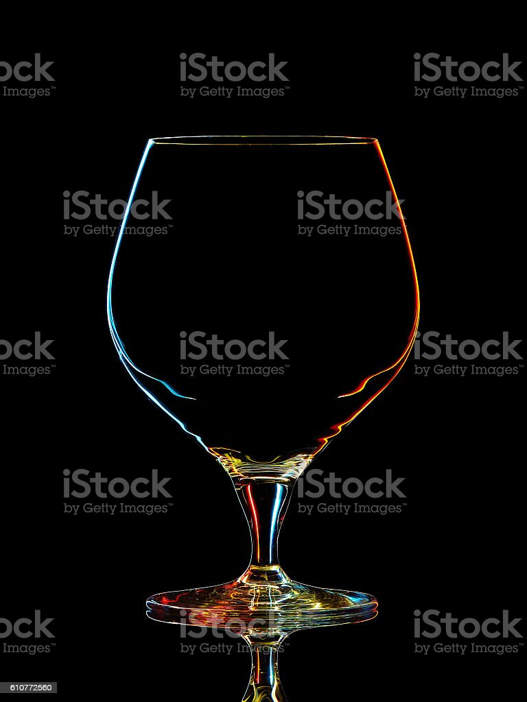 Silhouette of colorful whiskey glass with clipping path on black stock photo