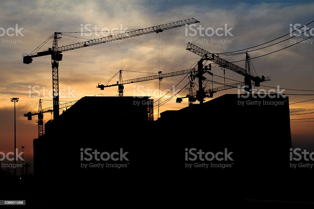 Silhouette of construction stock photo