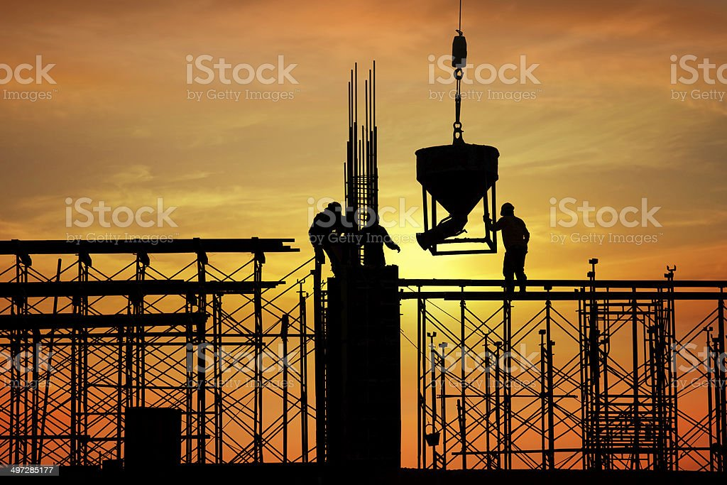 silhouette of construction worker on construction site stock photo