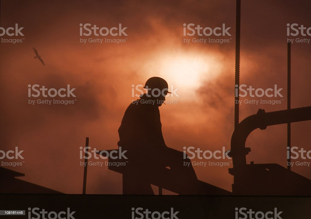 Silhouette of Construction Worker royalty-free stock photo