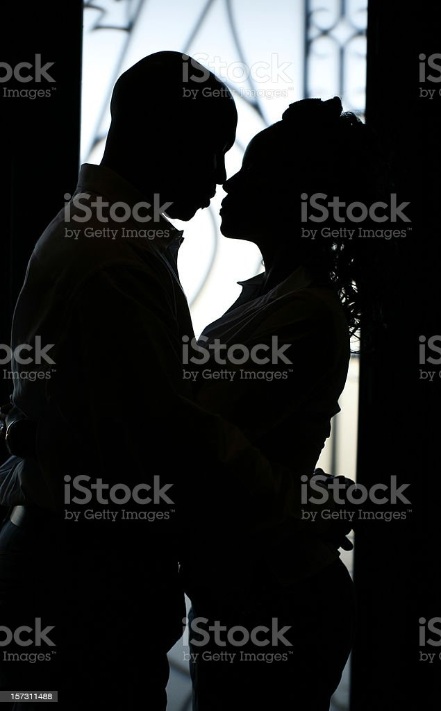 Silhouette of couple gazing closely at each other stock photo