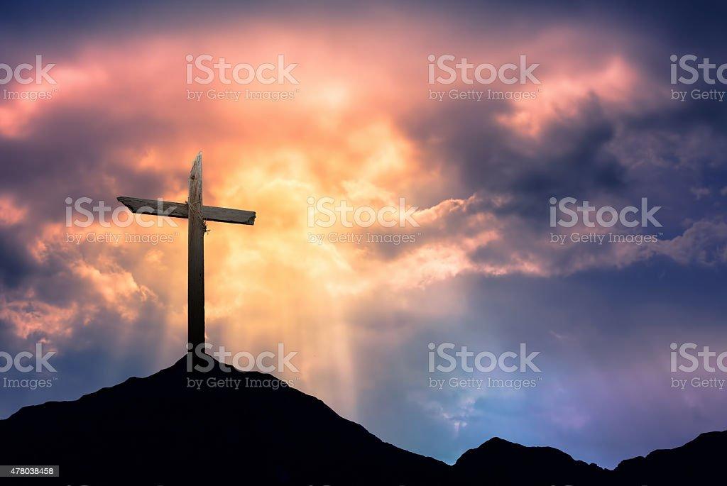 Silhouette of Cross at Sunrise stock photo