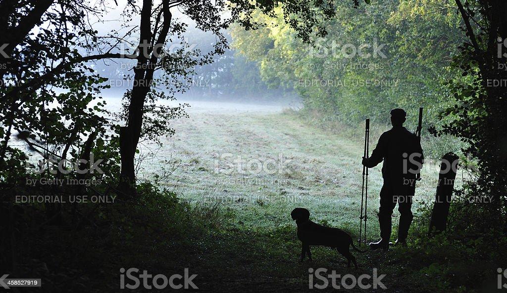 Silhouette of deer stalker royalty-free stock photo