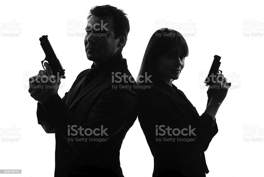 Silhouette of detective secret agents holding guns on white stock photo