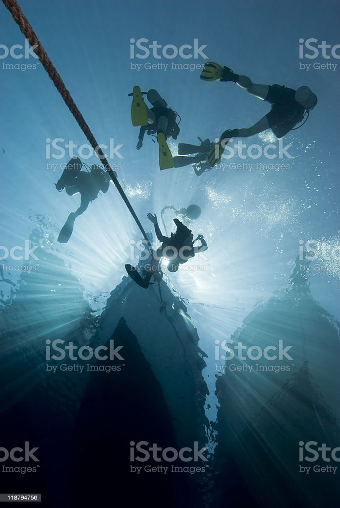Silhouette of divers and dive boat. stock photo