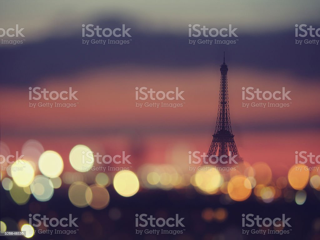 Silhouette of Eiffel tower and night lights of Paris, France stock photo