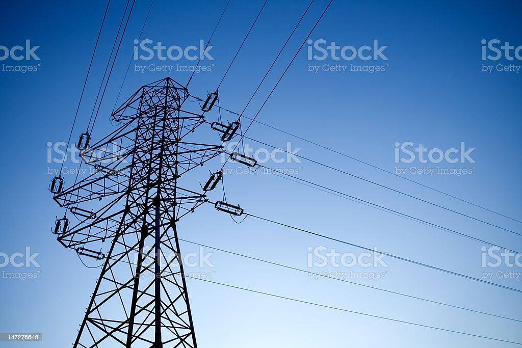 Silhouette of electrical pylon over blue sky royalty-free stock photo