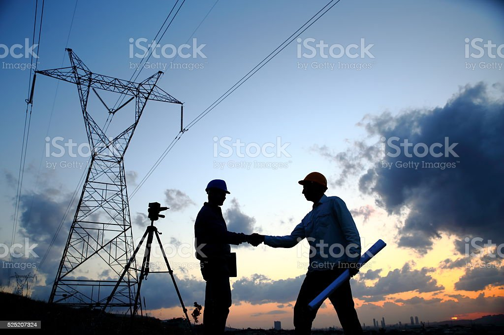 Silhouette of engineers workers at electricity station stock photo