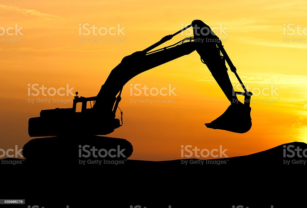 silhouette of Excavator loader at construction site with raised stock photo