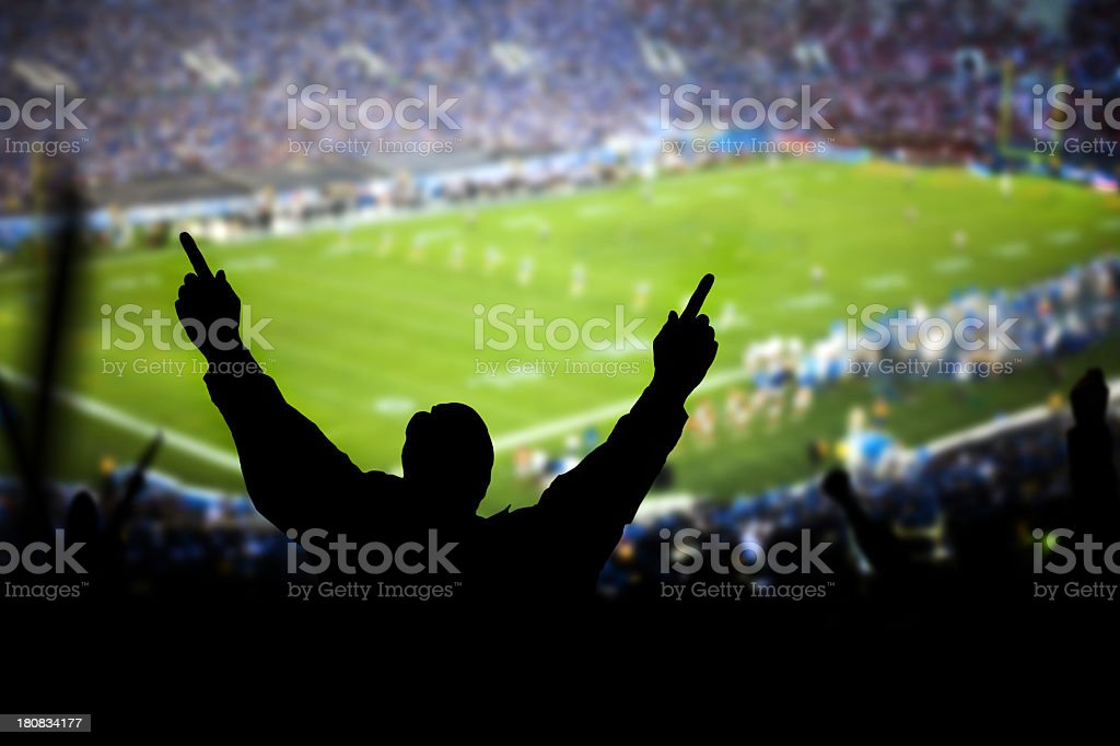 Silhouette of excited fans at football game royalty-free stock photo