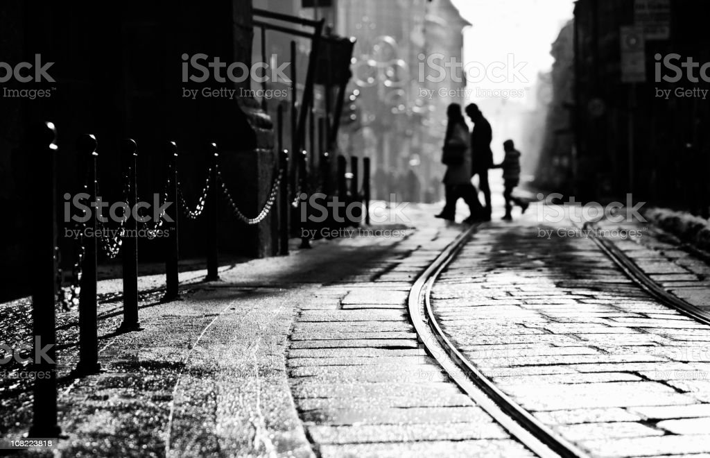 Silhouette of Family Walking in Milan Street, Black and White royalty-free stock photo