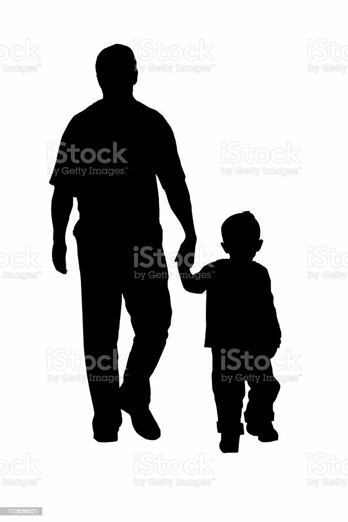 Silhouette of father and son walking royalty-free stock photo