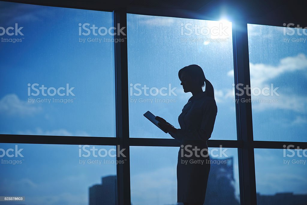 Silhouette of female employee stock photo