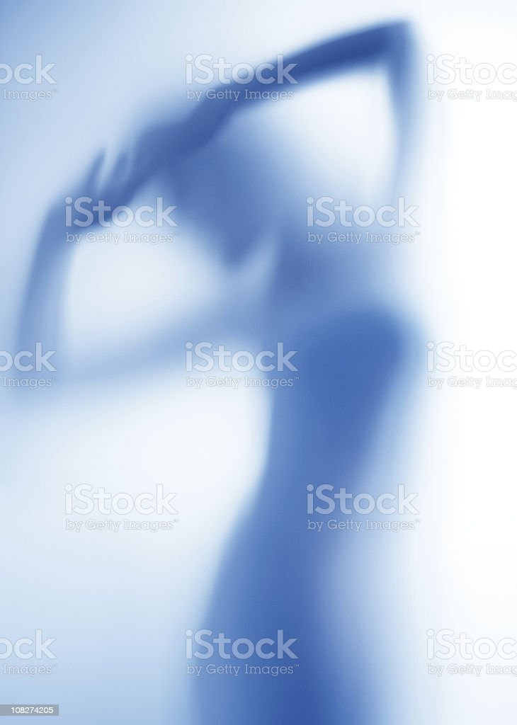 Silhouette of Female in Blue Shadows royalty-free stock photo