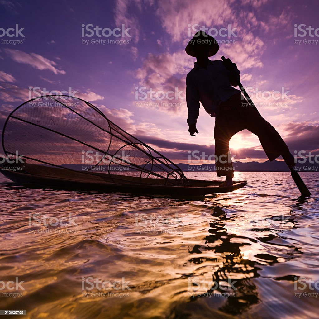 Silhouette of fisherman on Inle Lake, Myanmar stock photo