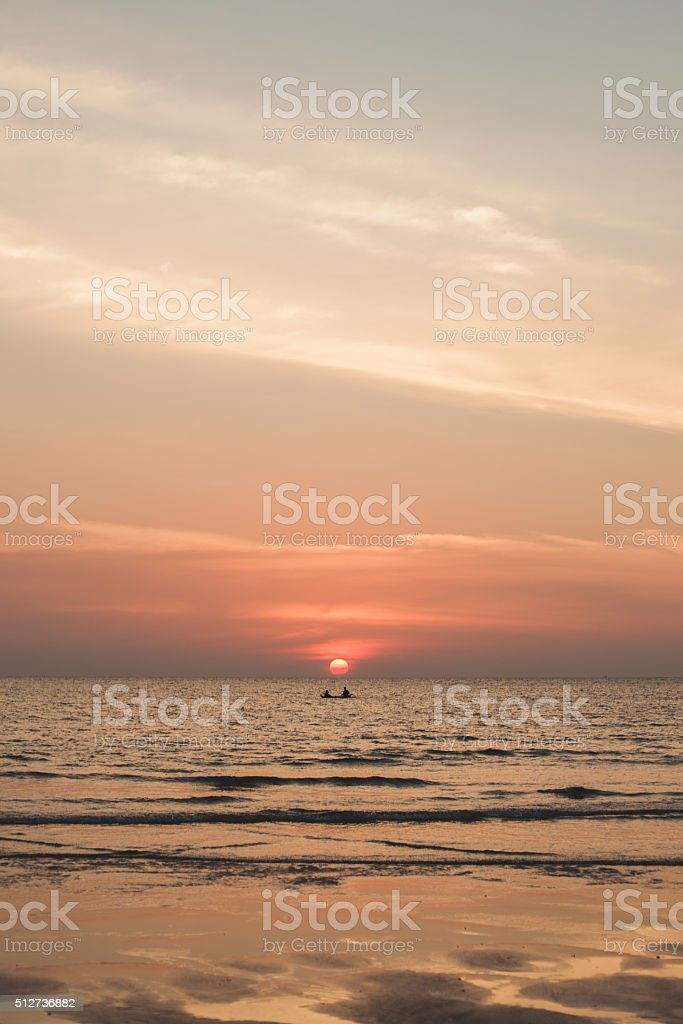 silhouette of fishermen boats fishing in sunset on the sea stock photo