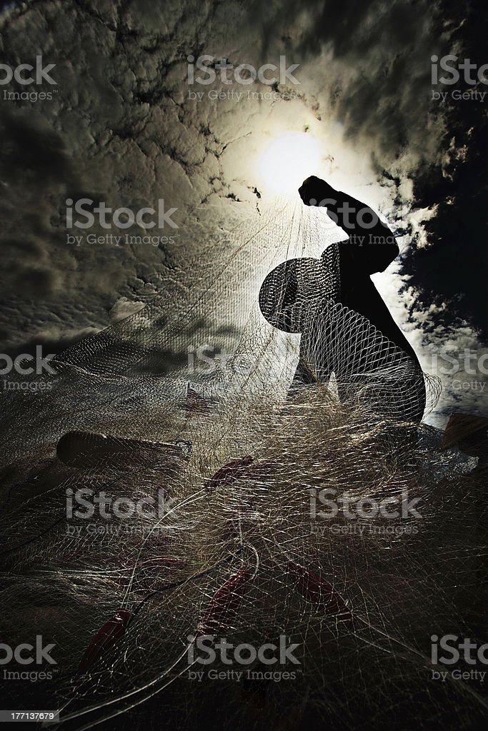 Silhouette of fishermen stock photo