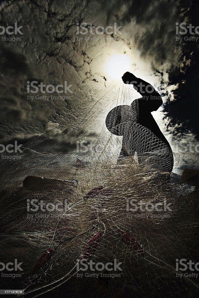 Silhouette of fishermen stock photo