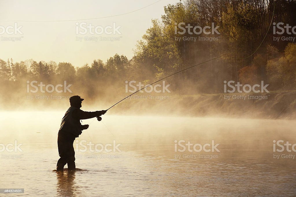 Silhouette of Fly Fisherman in Nova Scotia stock photo