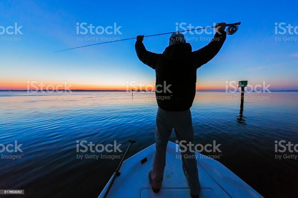 Silhouette of Fly Fisherman stock photo