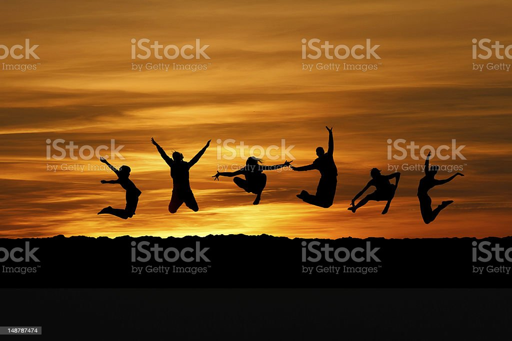 silhouette of friends jumping for fun royalty-free stock photo