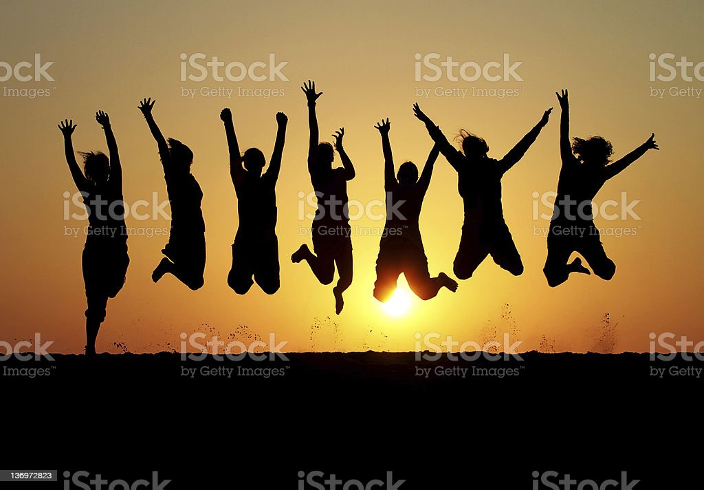 silhouette of friends jumping in sunset royalty-free stock photo