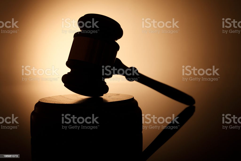 Silhouette of gavel on sounding block stock photo
