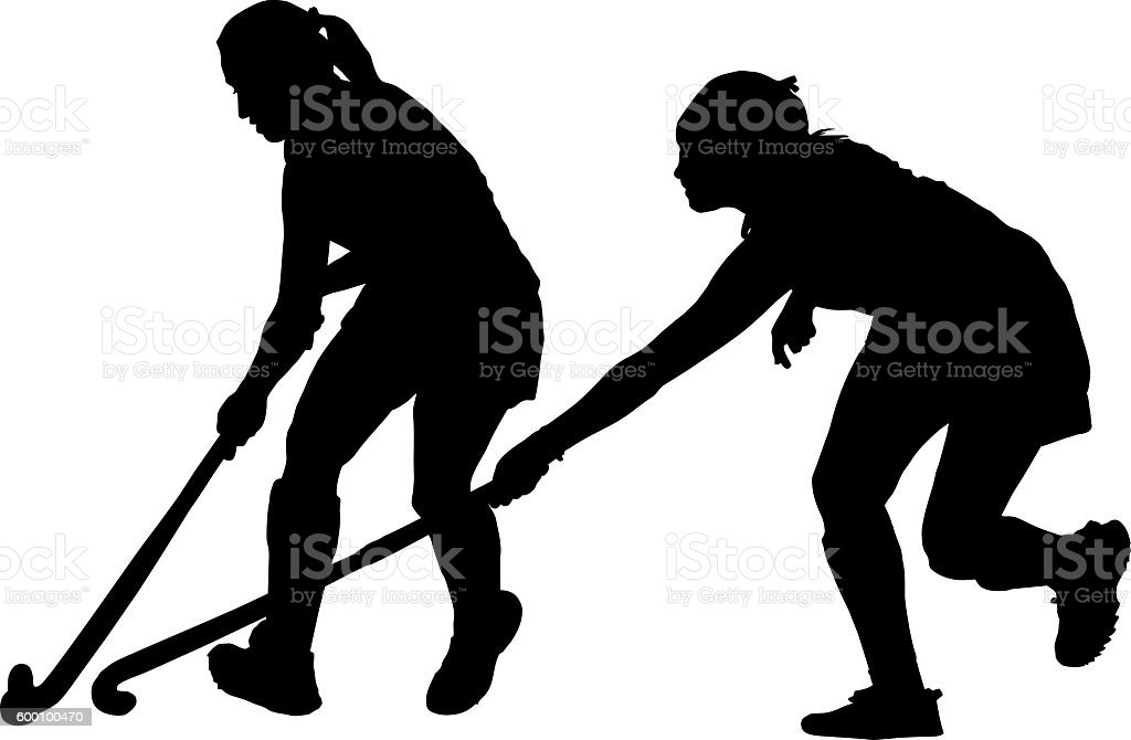 Silhouette of girl ladies hockey players battling for possession stock photo