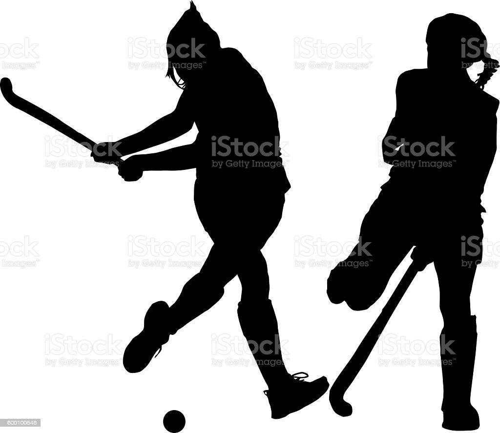 Silhouette of girl ladies hockey players hitting and blocking ba stock photo