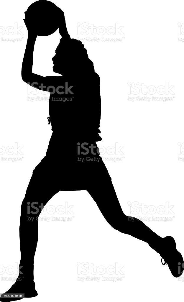 Silhouette of girls ladies netball player catching throwing ball stock photo