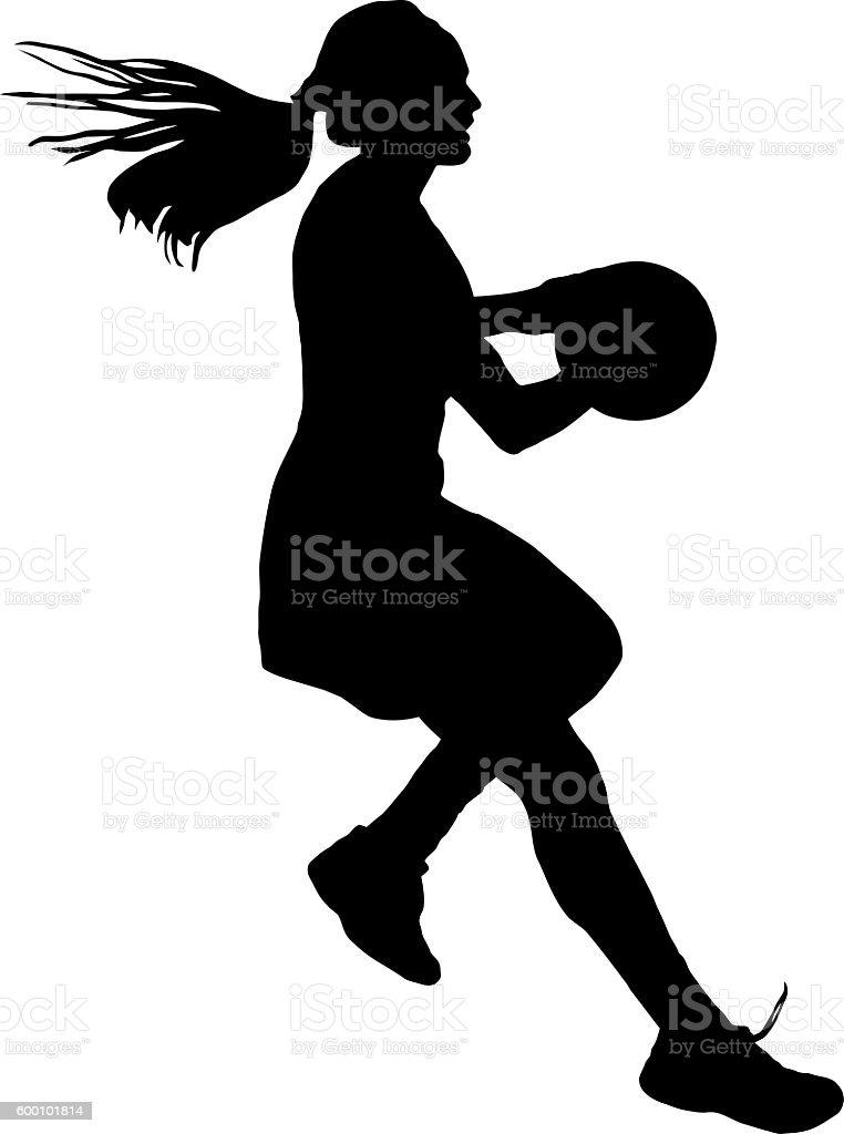 Silhouette of girls ladies netball player running with ball stock photo