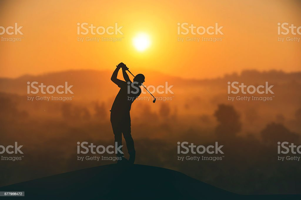 silhouette of golfers hit sweeping and keep golf course stock photo
