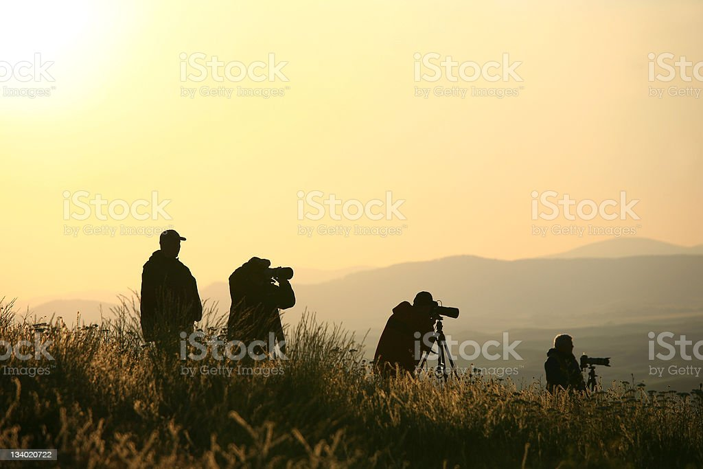 Silhouette of Group of Nature Photographers stock photo
