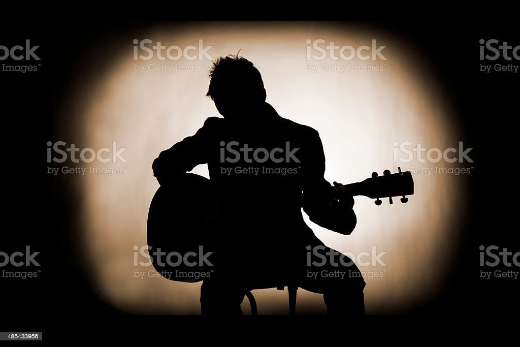 Silhouette of Guitarist In Vintage Style royalty-free stock photo