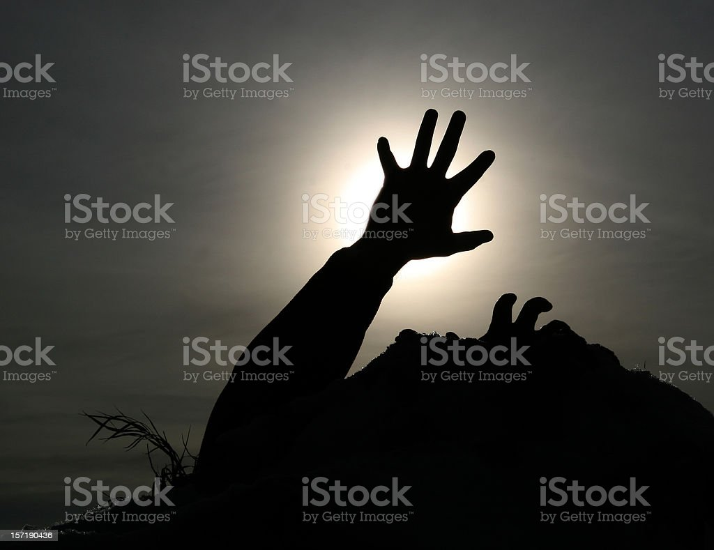 silhouette of hands reaching for a grip, blocking the sun  royalty-free stock photo