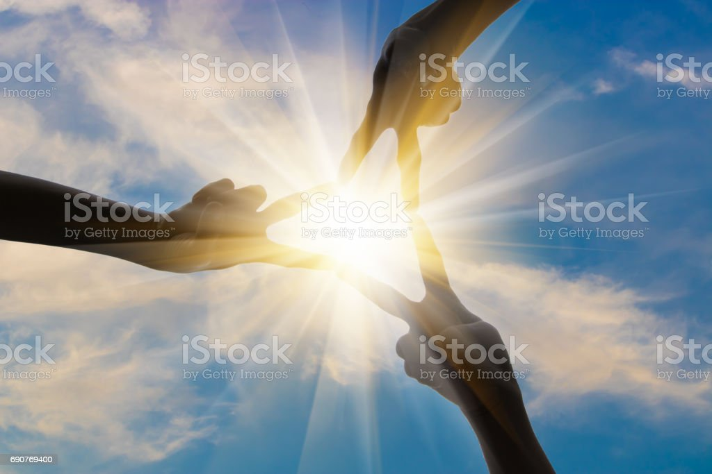 Silhouette of happy business team making join hands in sunset sky background for business teamwork concept stock photo
