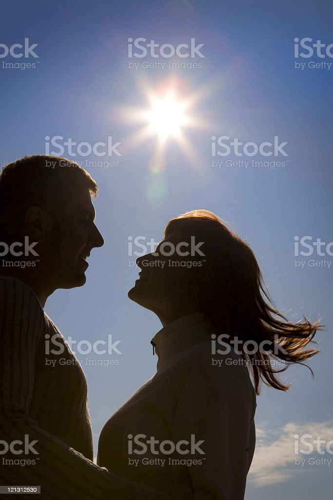 Silhouette of happy couple at the sky. royalty-free stock photo