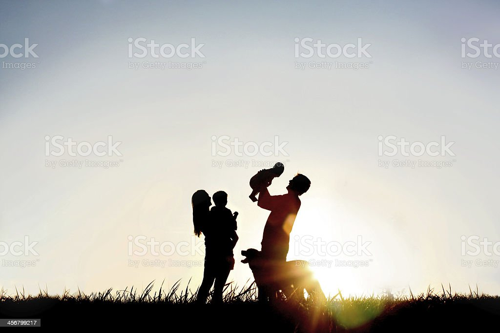 Silhouette of Happy Family and Dog stock photo