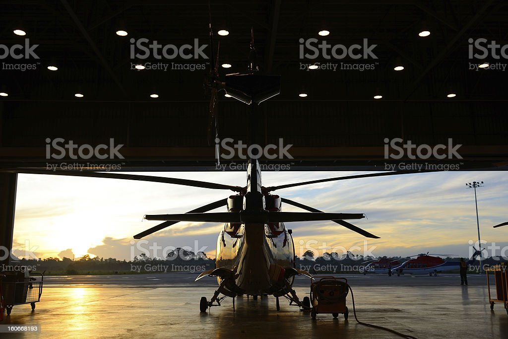 silhouette of helicopter in the hangar stock photo