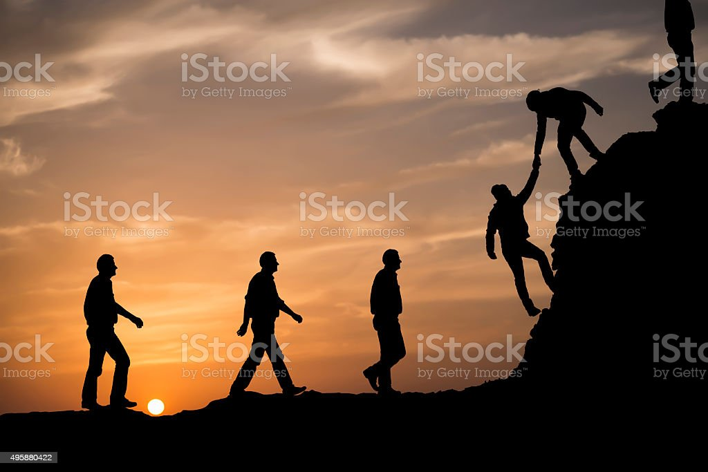 Silhouette of helping hand stock photo