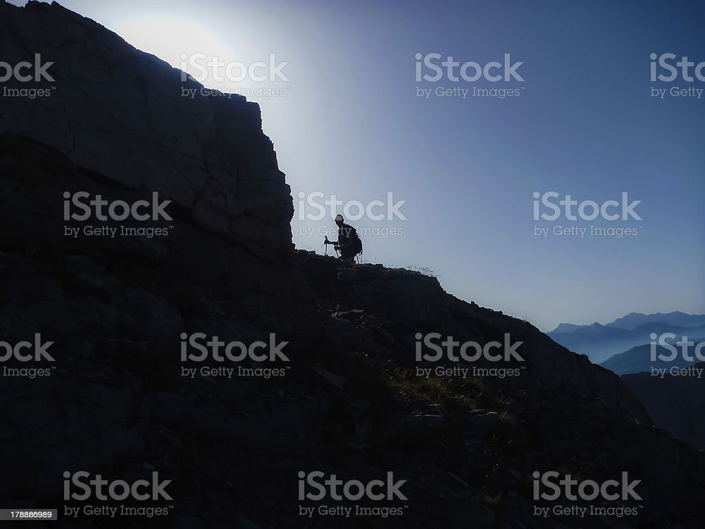 Silhouette of hiker along mountain ridge in the Alps royalty-free stock photo