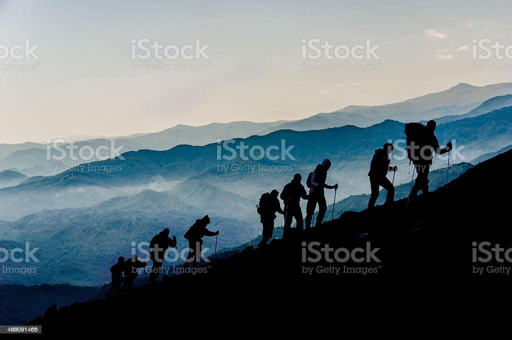 Silhouette of Hikers At Dusk stock photo