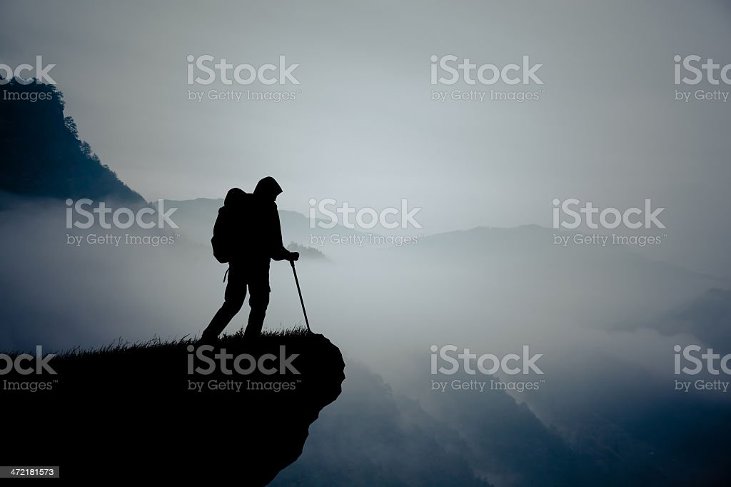 Silhouette of hiking man in mountain royalty-free stock photo