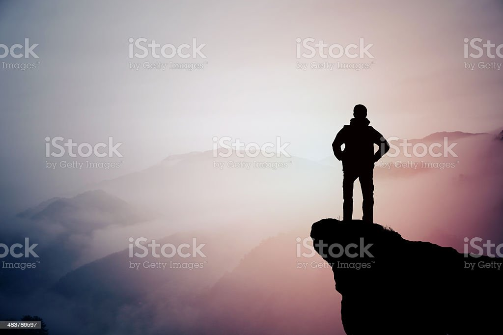 Silhouette of hiking man in mountain stock photo